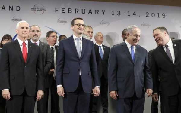 In this Thursday, Feb. 14, 2019 file photo, United States Vice President Mike Pence, Prime Minister of Poland Mateusz Morawiecki, Israeli Prime Minister Benjamin Netanyahu and United State Secretary of State Mike Pompeo, from left, stand on a podium at a conference on Peace and Security in the Middle East in Warsaw, Poland. A two-day security conference in Warsaw was supposed to be a crowning achievement for Israeli Prime Minister Benjamin Netanyahu, stamping a seal on his long-held goal of pushing his behind-the-scenes ties with Arab leaders into the open. Instead, the publicity-seeking Israeli leader made one embarrassing misstep after another, distracting attention from his main mission and sending his aides into a nonstop cycle of damage control. (AP Photo/Michael Sohn, File)