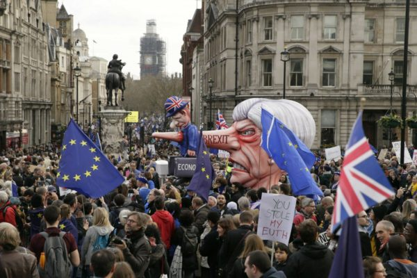 Hundreds of thousands of people opposed to the UK's withdrawal from the EU marched through central London to demand a new referendum as the deepening Brexit crisis risked sinking Prime Minister Theresa May's premiership.