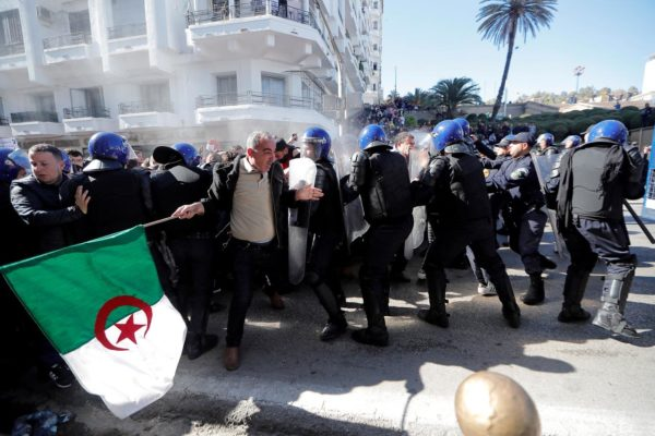 Police officers try to disperse people trying to reach the government palace during a protest against President Abdelaziz Bouteflika's plan to extend his 20-year rule by seeking a fifth term in April elections in Algiers, Algeria, March 1, 2019. REUTERS/Zohra Bensemra