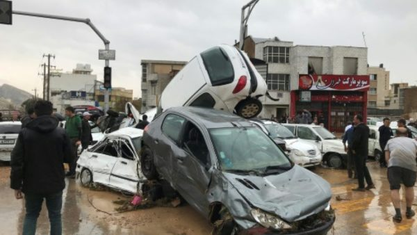 Cars pilled up in a street of the southern Iranian city of Shiraz where at least 11 people were killed and 68 injured in flooding Cars pilled up in a street of the southern Iranian city of Shiraz where at least 11 people were killed and 68 injured in flooding MEHR NEWS/AFP