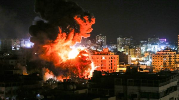 Flames and smoke are seen during an Israeli air strike in Gaza City [