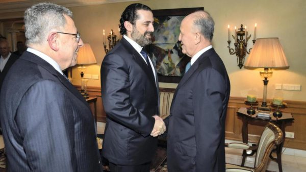 Prime Minister Saad Hariri shakes hands with former rival Ashraf Rifi as the two meet for a public reconciliation with former prime minister Fouad Siniora. Hand out image