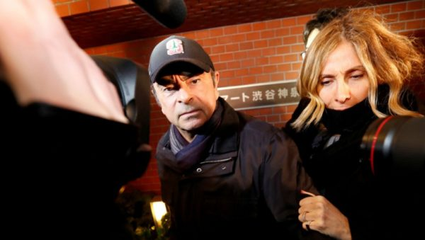 Issei Kato, Reuters (file photo) | Carlos Ghosn accompanied by his wife Carole Ghosn, arrives at his Tokoyo residence on March 8, 2019.