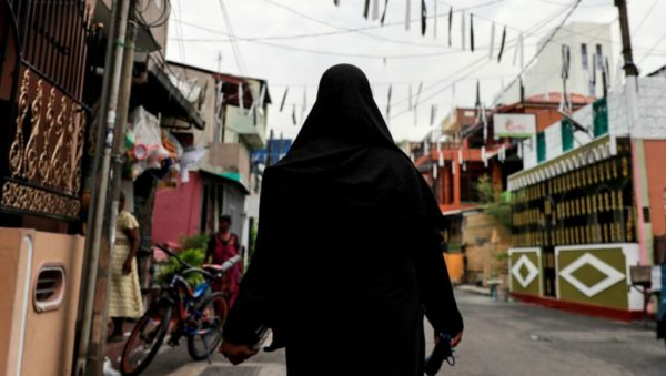 Danish Siddiqui, REUTERS | A woman wearing a face-covering veil walks through a street near St Anthony's Shrine in Colombo, days after Sri Lanka's deadly suicide attacks.