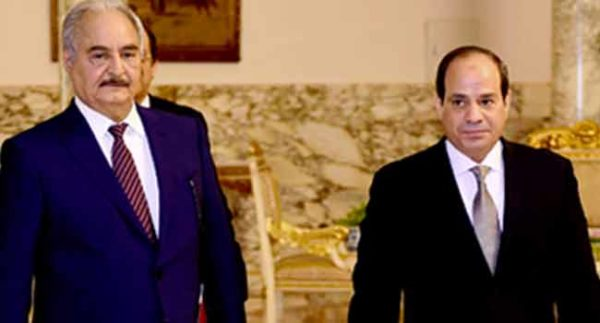 Libyan military commander Khalifa Haftar walks with Egyptian President Abdel Fattah al-Sisi at the Presidential Palace in Cairo, Egypt April 14, 2019 in this handout picture courtesy of the Egyptian Presidency. The Egyptian Presidency/Handout via REUTERS