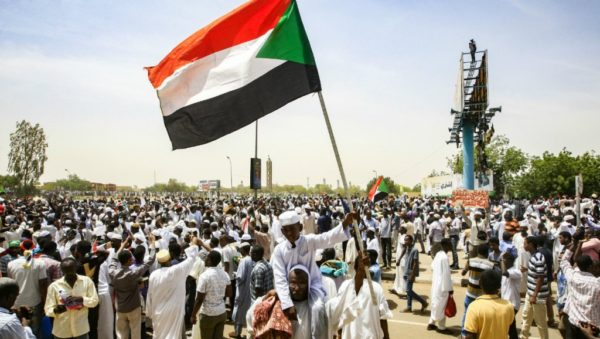Ebrahim Hamid, AFP | A Sudanese boy waves a national flag during a rally demanding a civilian body to lead the transition to democracy, outside the army headquarters in the Sudanese capital Khartoum on April 11, 2019.