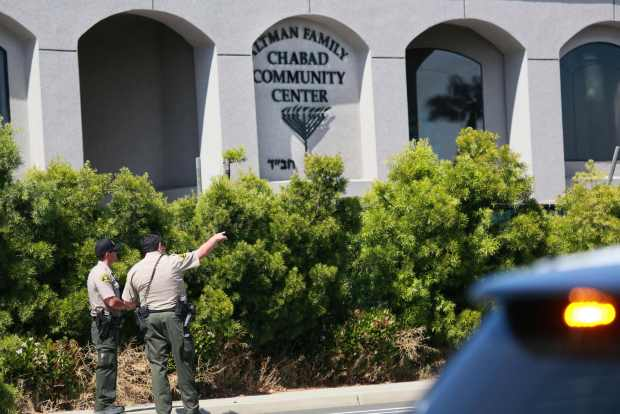 San Diego Sheriff deputies look over the Chabad of Poway Synagogue after a shooting on Saturday, April 27, 2019 in Poway, California.