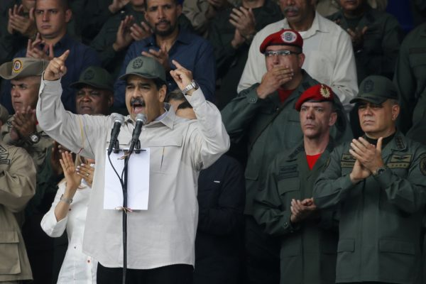 FILE - In this April 13, 2019 file photo, Venezuela's President Nicolas Maduro, speaks flanked by Defense Minister Vladimir Padrino Lopez, right, and Gen. Ivan Hernandez, second from right, head of both the presidential guard and military counterintelligence in Caracas, Venezuela. The Associated Press has learned that at least twice since 2016, the U.S. government missed chances to cultivate relations with regime insiders, including Padrino and Hernández, who National Security Adviser John Bolton said backed out of a plan to topple Maduro. (AP Photo/Ariana Cubillos, File)