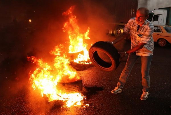 A Lebanese army veteran burns tires during a protest over a state budget that includes a provision taxing their pensions, in Naameh, south of Beirut, Lebanon June 27, 2019. REUTERS/Aziz Taher