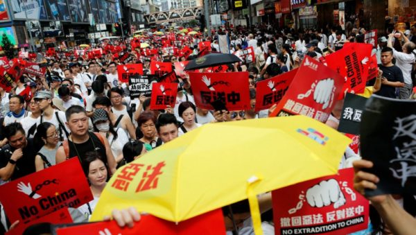 Demonstrators hold yellow umbrellas, the symbol of the Occupy Central movement, and placards during a protest to demand authorities scrap a proposed extradition bill with China, in Hong Kong, China June 9, 2019.
