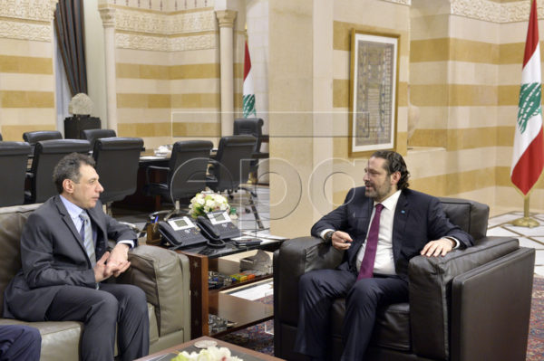 Lebanese Prime Minister Saad Hariri (R) meets with Nizar Zakka (L) a Lebanese citizen and permanent US resident who was released in Tehran after nearly four years in jail on charges of spying