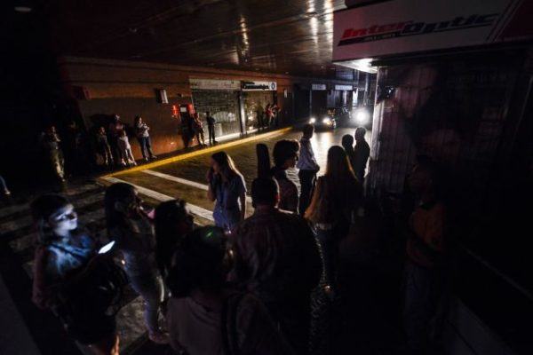 People wait at the parking of a shopping centre in Caracas on July 22, 2019 as the capital and other parts of Venezuela are being hit by a massive power cut. MATIAS DELACROIX   AFP   Getty Images