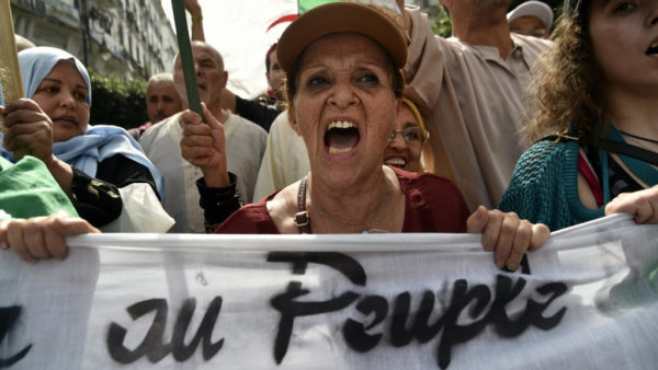 Ryad Kramdi, AFP | Algerian protesters take part in a demonstration against the country's army chief in Algeria's capital Algiers on September 20, 2019, as the police toughens its line ahead of December elections.