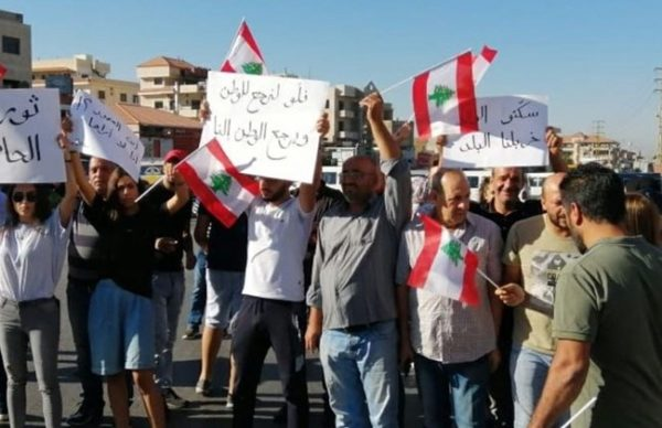 Demonstrators block a road in Baalbeck, Sept. 29, 2019 in protest against the worsening economic situation