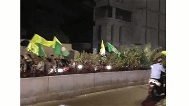 Hezbollah amal supports roam beirut streets over motorbikes