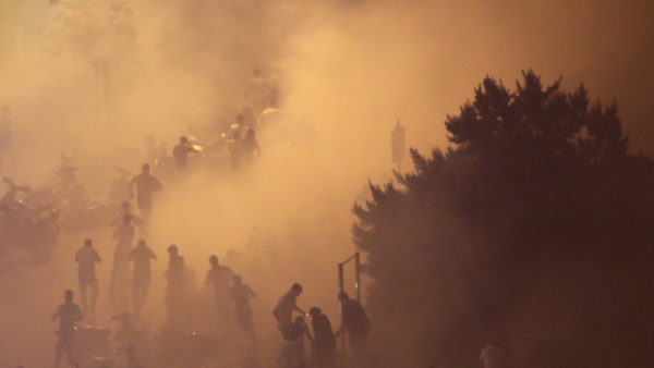 Lebanese riot police fire tear gas during a protest against government's plans to impose new taxes in Beirut, Lebanon.CREDIT:AP
