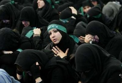 Female members of Lebanon's Hezbollah cry during the Ashura ceremony held in Beirut's suburbs December 27, 2009.