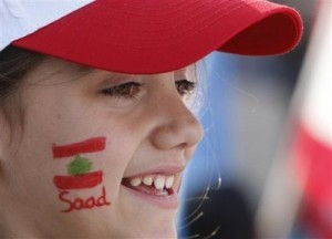 A Lebanese girl who painted her face with a national flag and the first name of the Lebanese Prime Minister Saad Hariri during the rally