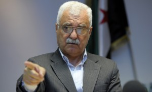 George Sabra, a member of the Syrian National Council leadership and official spokesman, attends a news conference in Paris