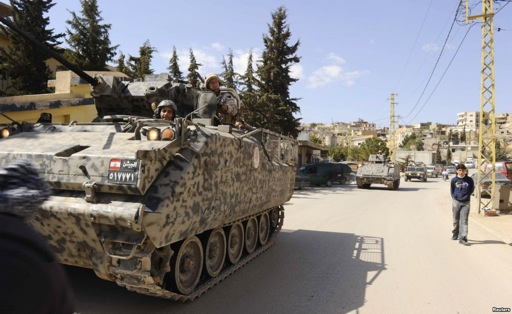 Lebanese army soldiers patrol the border town of Arsal in an armored vehicle.