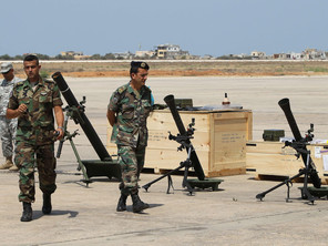Lebanese soldiers walk past 120 mm (L) and 81 mm mortars after a shipment of weapons was delivered by a US air force plane on August 29, 2014 at a Lebanese military base at Beirut International Airport. The United States is supplying Lebanon's army with additional munitions and ordnance in a bid to bolster the force after clashes with jihadists in the eastern Arsal region of the country, on the Syrian border. AFP PHOTO/ANWAR AMRO