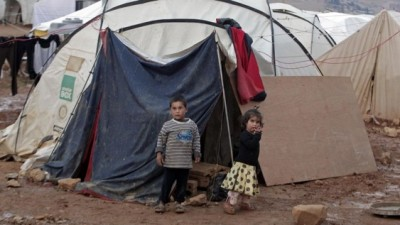 Syrian children stand near their tent at a refugee camp in the eastern Lebanese border town of Arsal, Lebanon, on Monday, November 18, 2013. (photo credit: AP Photo/Bilal Hussein)