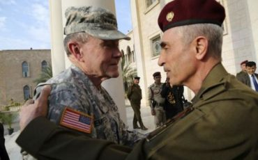 Iraq's army chief General Babakir Zebari meets with U.S. Army General Martin Dempsey, chairman of the Joint Chiefs of Staff, at the defence ministry in Baghdad