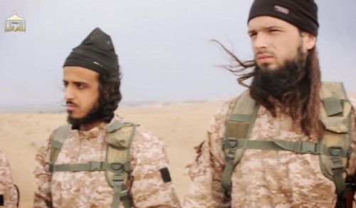 The video released Sunday shows members of ISIS, among them a jihadist believed to be French citizen Maxime Hauchard (R)