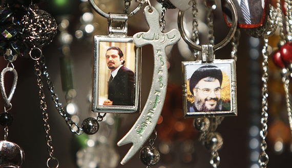 Pictures of Lebanon's Hezbollah leader Sayyed Hassan Nasrallah (R) and former Prime Minister Saad al-Hariri are seen on key rings at a gift shop in the port city of Sidon, southern Lebanon. Hariri's support for dialogue with Hezbollah