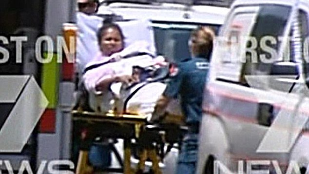 Mersane Warria  is pictured being taken away by paramedics from a Cairns home on Friday