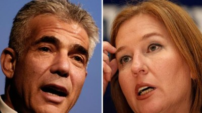 Israeli Finance Minister Yair Lapid, left, and Justice Minister Tzipi Livni, who were relieved of their positions Tuesday. (Gali Tibbon / AFP/Getty Images)