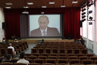 TV broadcast showing Russia's President Vladimir Putin delivering his annual state of the union speech to members of parliament and other top officials in the Kremlin, in Stavropol, December 4, 2014.