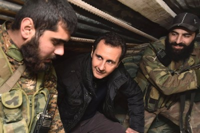 President Bashar al-Assad (C)   visiting the frontlines near Damascus on the first day of the new year. His regime may be cooperating with Iran and North Korea on the construction of a nuclear bomb.