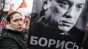 People march in memory of Russian opposition leader and former Deputy Prime Minister Boris Nemtsov on March 01, 2015 in central Moscow, Russia.