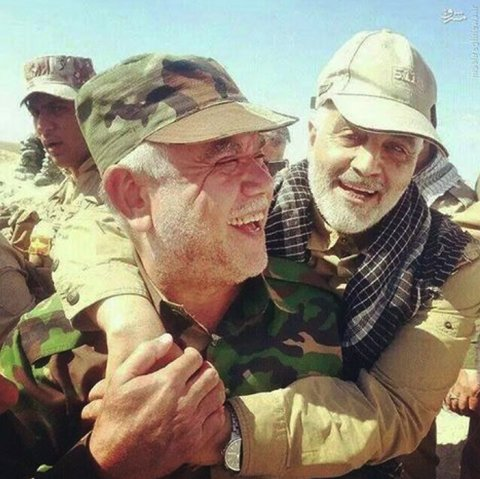 "Qassem Suleimani (R) celebrating with Hadi al-Amiri, chief of Iraqi Shiite militias , during the liberation of Jawlala in Iraq from the Islamic State. ""Suleimani , the head of the Qods Force, the foreign arm of Iran's Revolutionary Guards Corps is the leader of the Shiite militias in Lebanon, Syria, Iraq and Yemen,"" a top military analyst was quoted as saying . Commenting on Iran's interference in Iraq Saudi FM prince Faisal told US Secretary of State John Kerry on March 5: ""Iran is taking over Iraq"""