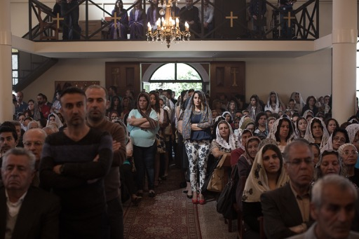 Hundreds of Assyrian families, some of them recently arrived from Islamic State controlled areas of Syria, attend Easter Sunday service at St. Georges Assyrian Church of The East in Sed El Baouchrieh, a working class suburb of Beirut.