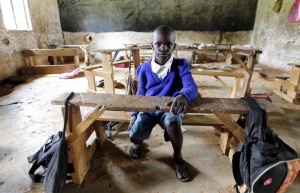 Seven-year-old Barack Obama Okoth, named after U.S. President Barack Obama, sits inside an empty classroom as he speaks with Reuters at the Senator Obama primary school in Nyangoma village in Kogelo ,west of Kenya's capital Nairobi, June 23, 2015.   REUTERS/Thomas Mukoya