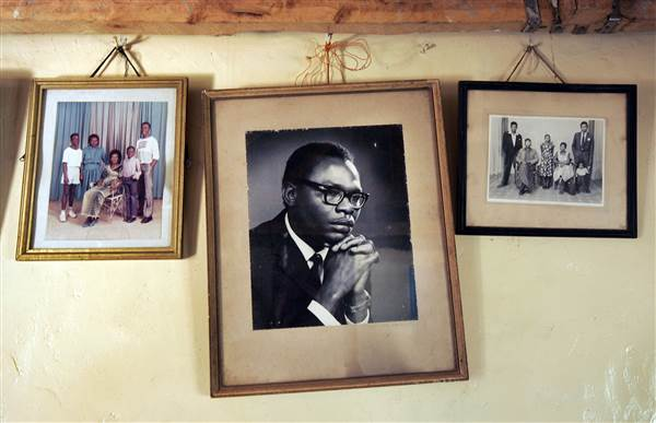 In this Feb. 5, 2008 file photo, a photograph of Barack Obama Sr., father of Democratic presidential hopeful, Sen. Barack Obama, D-Ill., hangs on the wall of his grandmother Sarah Hussein Obama's house in the village of Kogelo, near the shores of Lake Victoria, Kenya. Ben Curtis / AP file
