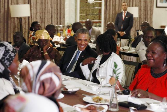 President Obama attends a private dinner with family members at his hotel restaurant after arriving in Nairobi July 24, 2015.  REUTERS/Jonathan Ernst