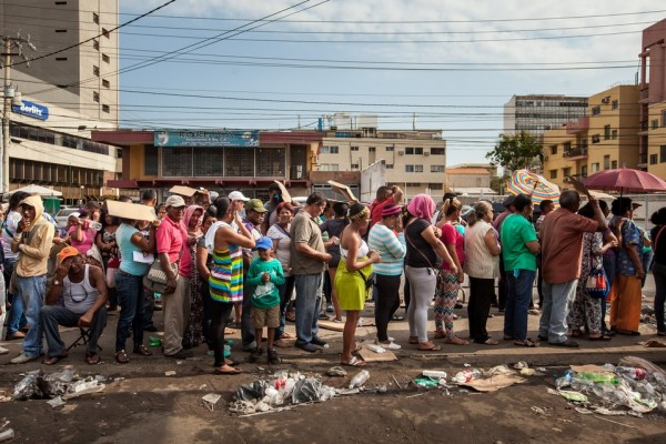 """Shoppers wait in a long line to enter the """"Latino Supermarket"""" in the Dr. Portillo area of Maracaibo, Venezuela.MIGUEL GUTIÉRREZ FOR THE WALL STREET JOURNAL"""