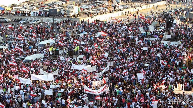 "Thousands of protesters waving Lebanese flags and chanting ""revolution"" took to the streets of Beirut on Saturday  Aug 29, 2015 for an unprecedented mobilization against sectarian politicians they say are incompetent and corrupt."