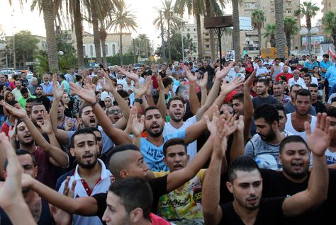 Lebanese protesters chant slogans during a demonstration, in support of the 'You Stink' campaign, to protest against the ongoing country's trash crisis on August 24, 2015, in Lebanon's southern port city of Sidon. (AFP/Getty Images)