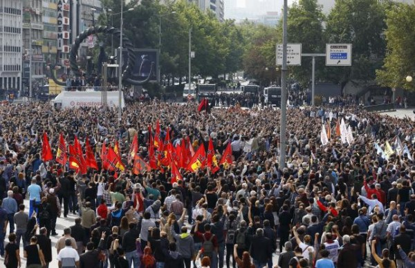 People gather in a square during a commemoration for the victims of Saturday's bomb blasts in the Turkish capital, in Ankara, Turkey, October 11, 2015. REUTERS/Umit Bektas