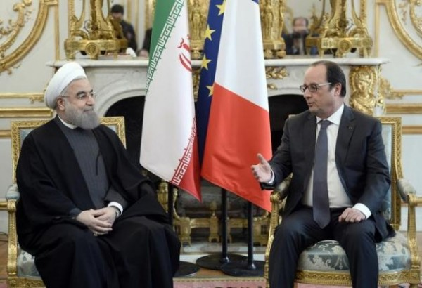 French President Francois Hollande (R) meets Iran's President Hassan Rouhani at the Elysee Palace in Paris, France, January 28, 2016.  REUTERS/Stephane de Sakutin/Pool