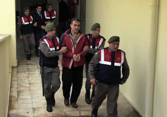 The police escorted Syrian smugglers Muwafaka Alabash, front, and Asem Alfrhad, rear, for their trial in Bodrum, Turkey, on Friday. Credit Associated Press