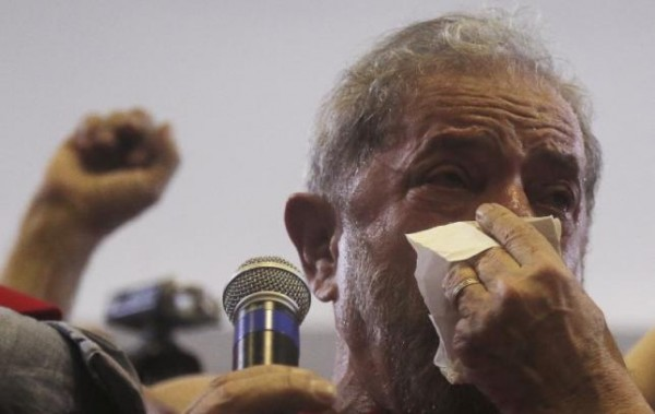 FILE PHOTO: Former Brazil's President Luiz Inacio Lula da Silva cries as he speaks to supporters at the bank workers' trade union site in Sao Paulo, Brazil, March 4, 2016. REUTERS/Paulo Whitaker