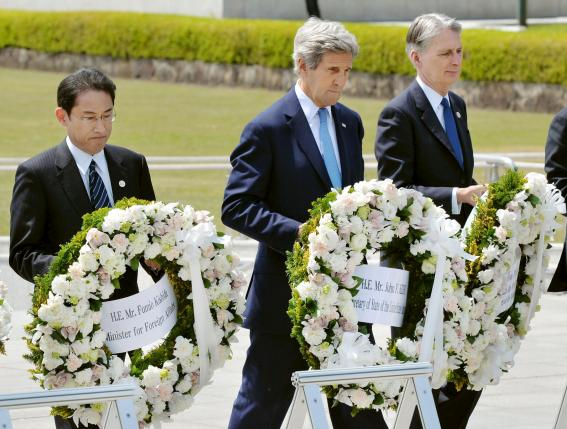 U.S. Secretary of State John Kerry (2nd L) prepares to lay a wreath at the cenotaph with Japan's Foreign Minister Fumio Kishida (L), Britain's Foreign Minister Philip Hammond and other fellow G7 foreign ministers at Hiroshima Peace Memorial Park and Museum in Hiroshima, Japan, in this photo released by Kyodo April 11, 2016. Mandatory credit REUTERS/Kyodo