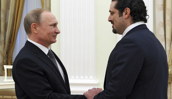 Russia's President Vladimir Putin (L) welcomes Lebanon's former prime minister Saad al-Hariri during a meeting at the Kremlin in Moscow, Russia, April 1, 2016. REUTERS/Michael Klimentyev/Sputnik/Kremlin ATTENTION EDITORS - THIS IMAGE HAS BEEN SUPPLIED BY A THIRD PARTY. IT IS DISTRIBUTED, EXACTLY AS RECEIVED BY REUTERS, AS A SERVICE TO CLIENTS.   - RTSD5XC