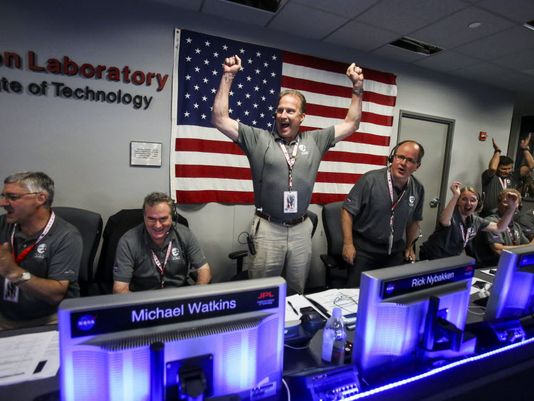 From left to right, Geoffrey Yoder, Michael Watkins, Rick Nybakken, Richard Cook and Jan Chodas celebrate in Mission Control at NASA's Jet Propulsion Laboratory as the solar-powered Juno spacecraft goes into orbit around Jupiter on Monday in Pasadena, Calif. (Photo: Ringo H.W. Chiu, AP)
