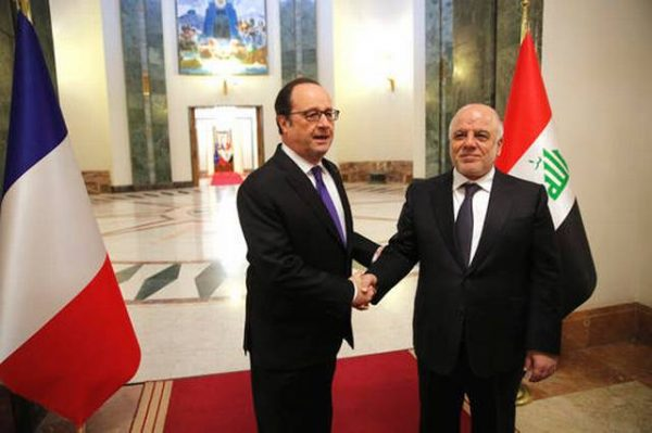 Iraq's Prime Minister Haider al-Abadi, right, greets French President Francois Hollande prior to their meeting in Baghdad, Iraq, Monday, Jan. 2, 2017. Hollande is in Iraq for a one-day visit. Christophe Ena, Pool AP Photo